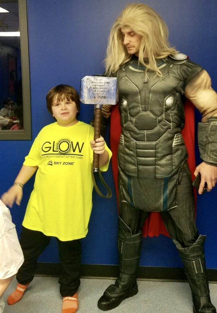 Thor with child holding hammer