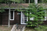 PINE AIRE. Two bedroom vacation home for 4. Includes a living room with a fireplace and a full kitchen.