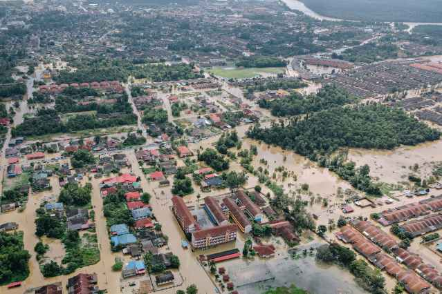flooded town with residential buildings and trees