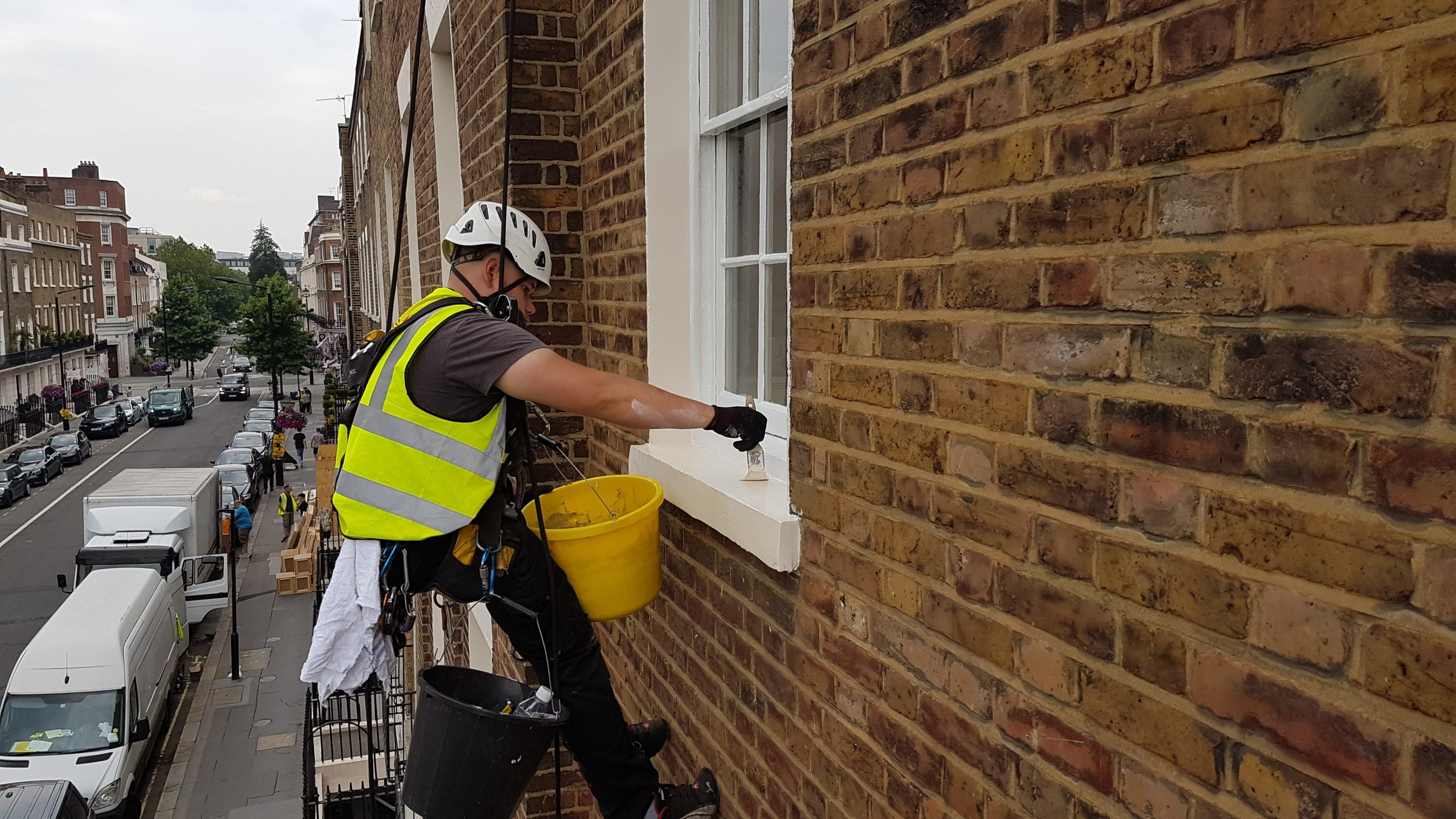 abseiling sash window painting