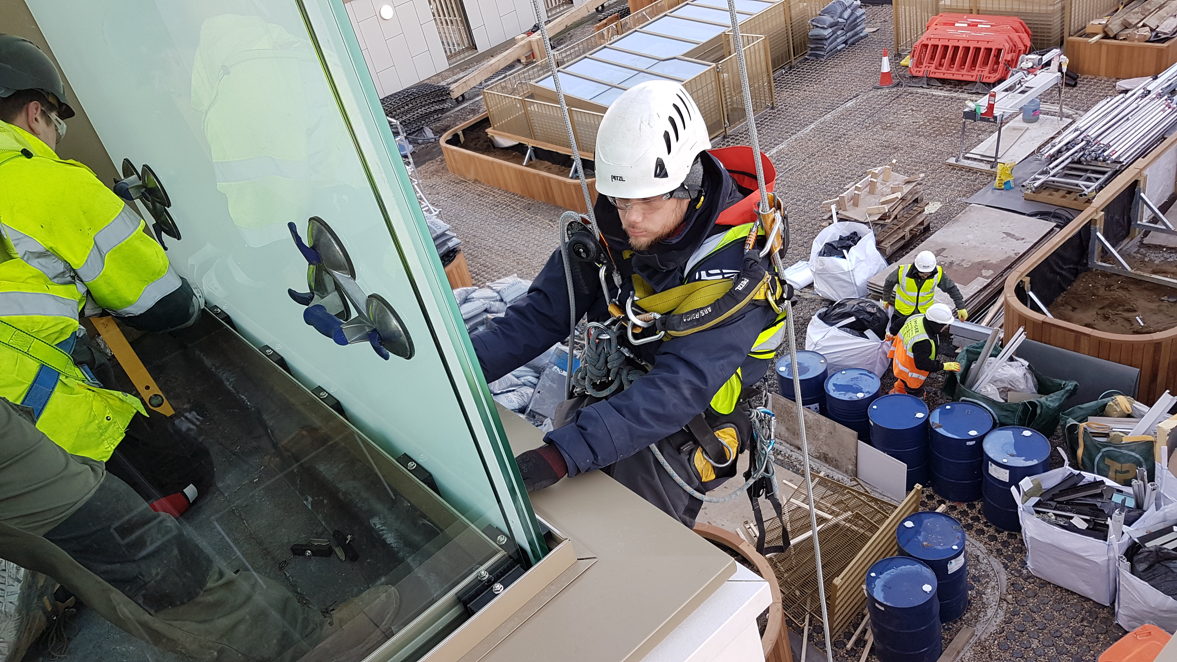 abseiling glass installation