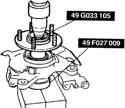 How do I remove the front rotor on a 2003 mazda protege