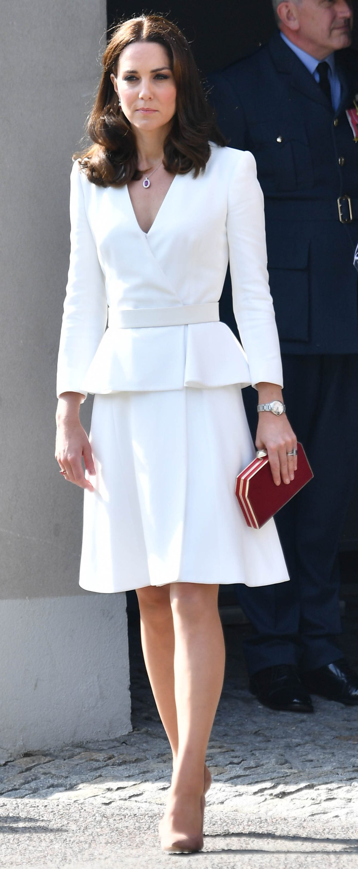 Catherine, Duchess of Cambridge, wore a white Alexander McQueen peplum dress to begin her visit to Warsaw.  Picture by Andrew Parsons / i-Images