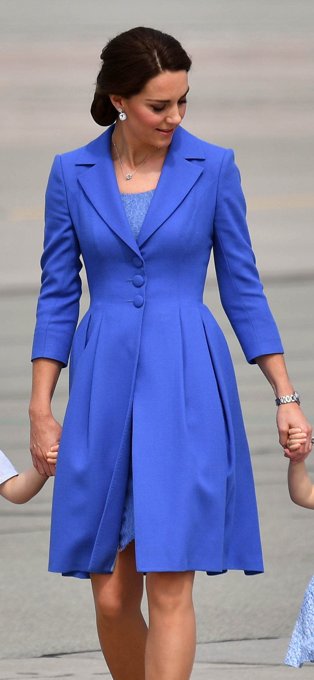 Image ©Licensed to i-Images Picture Agency. 19/07/2017. Warsaw, Poland. Royal Tour of Poland and Germany-Day Three. Prince William, The Duke of Cambridge, joined by his wife Catherine, The Duchess of Cambridge with their children Prince George and Princess  Charlotte depart Warsaw airport, Poland after a three day visit,  for Berlin, Germany, for the next stage of their European tour.  Picture by Andrew Parsons / i-Images