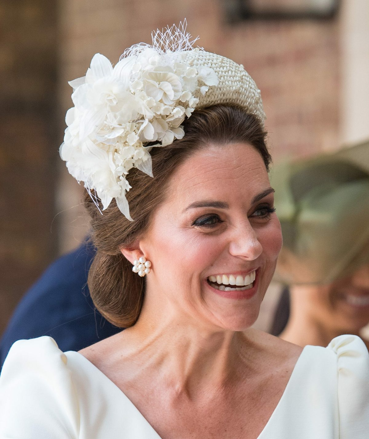The Duchess of Cambridge wears a headpiece for the christening of Prince Louis at St James's Palace. Picture by  i-Images / Pool