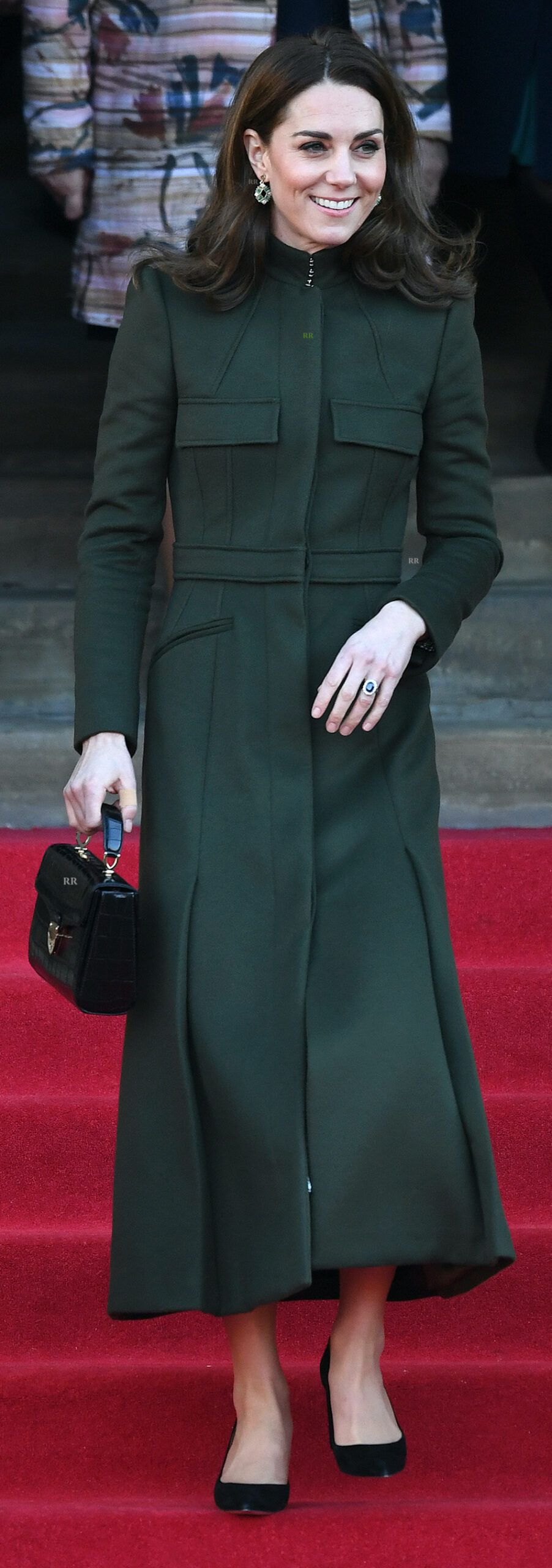 The Duchess of Cambridge in a custom dark green maxi coat from McQueen, on a visit to Bradford.