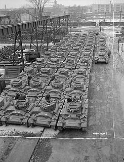 Valentine tanks from the Angus Shops (Montreal) awaiting loading on railway flat beds for shipment to Russia / Chars d'assaut Valentine provenant des ateliers Angus, à Montréal, avant leur chargement sur des wagons plats et leur expédition en Russie