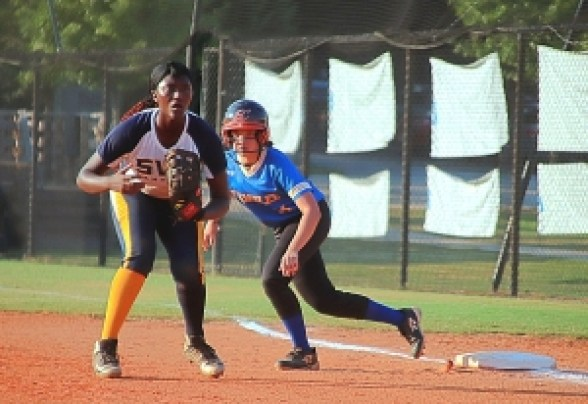 Southwest DeKalb first baseman Aniyah Lee (left) hit a huge fifth inning grand slam homer in the Lady Panthers' 8-6 win over Chamblee's Emily Katz (right) and her teammates at Chamblee on Thursday. (Photo by Mark Brock)