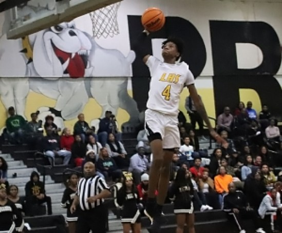 Lithonia senior guard Eric Gaines goes in for a dunk as part of his 33 points to lead the Bulldogs in a 67-58 win over Arabia Mountain at home on Tuesday night. (Photo by Mark Brock)