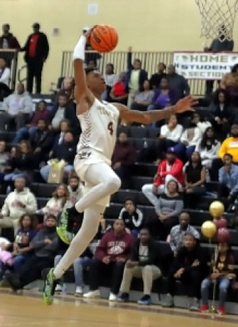 Jermontae Hill goes in for the first of two big dunks in the third quarter as No. 1 ranked Tucker began to pull away from Mundy's Mill for an 82-51 victory on Senior Night. (Photo by Mark Brock)