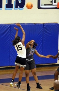 Cedar Grove's Lelah Easterly (15) gets off a shot during first half play of the Lady Saints Sweet 16 loss at the hands of No. 3 Beach. (Photo by Lester Wright)
