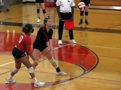 Druid Hills Aizja Rawls (10) and Ansley Glass (8) prepare for a return of serve against Cedartown in the first round of the Class 4A state playoffs. (Photo by Mark brock)