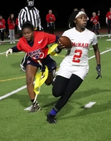 Dunwoody's Courtney Craft (left) makes a tackle on McNair's Kei'Asia Clayton (2) during second half action of McNair's 19-6 win. (Photo by Mark Brock)