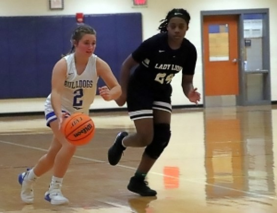 Chamblee's Savannah Russell (2) dribbles up court against Martin Luther King's Jana Berry during King's 49-28 Region 5-5A victory. (Photo by Mark Brock)