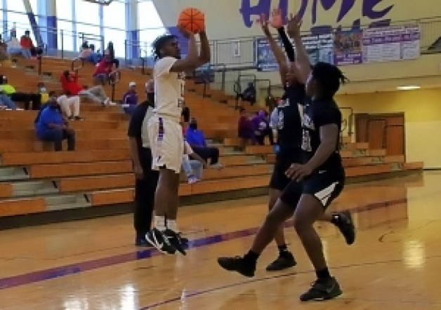 Miller Grove's Kyair Greene (11) shoots over Luella's Isaiah Duffy (21) and Joe Keeton (3). Greene hit for all 19 of his points in the second half to lead Miller Grove to a 60-51 comeback victory to advance to the Class 4A boys' Elite Eight. (Photo by Mark Brock)