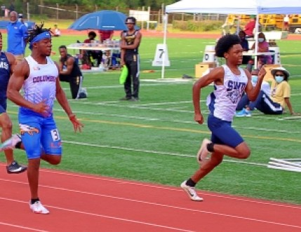 Southwest DeKalb's Antonio Davis (right) won the 100-meter dash over Columbia's Jordan Ammos and went on to capture gold in the 200-meter dash. (Photo by Mark Brock)