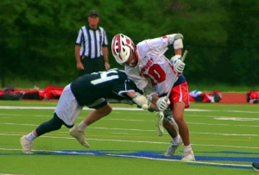 Dunwoody's Casey Blum (10) battles for the face off vs. North Atlanta. Blum and his Wildcat teammates take on No. 5 Harrison in the first round of the Class 6A/7A State Playoffs. (Photo by Mark Brock)