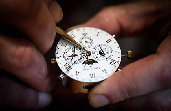 BASEL, SWITZERLAND - MARCH 23: A watchmaker moves a watch hands on the Blancpain booth at the BaselWolrd watch fair on March 23, 2018 in Basel, Switzerland. The annual watch trade fair sees the very latest horological designs unveiled from companies from all over the world. (Photo by Harold Cunningham/Getty Images)