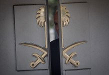 ISTANBUL, TURKEY - OCTOBER 10: A security guard looks out the front door of Saudi Arabia's consulate on October 10, 2018 in Istanbul, Turkey. Fears are growing over the fate of missing journalist Jamal Khashoggi after Turkish officials said they believe he was murdered inside the Saudi consulate. Saudi consulate officials have said that missing writer and Saudi critic Jamal Khashoggi went missing after leaving the consulate, however the statement directly contradicts other sources including Turkish officials. Jamal Khashoggi a Saudi writer critical of the Kingdom and a contributor to the Washington Post was living in self-imposed exile in the U.S. (Photo by Chris McGrath/Getty Images)