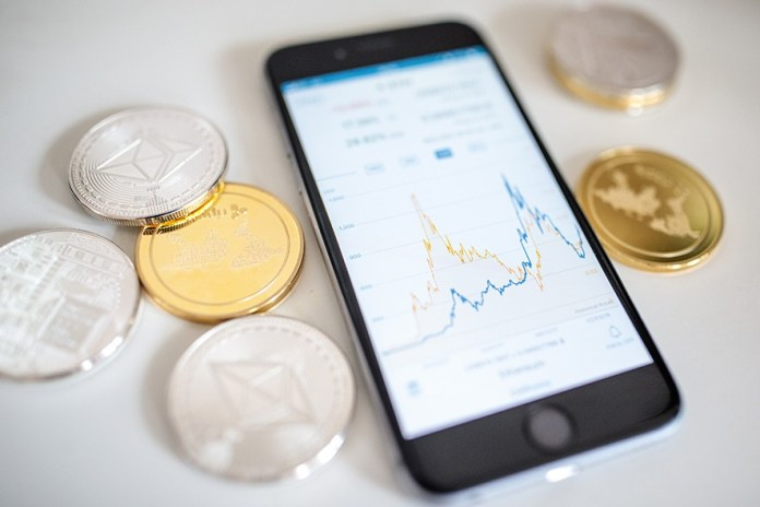 LONDON, ENGLAND - APRIL 25: In this photo illustration of the litecoin, ripple and ethereum cryptocurrency 'altcoins' sit arranged for a photograph beside a smartphone displaying the current price chart for ethereum on April 25, 2018 in London, England. Cryptocurrency markets began to recover this month following a massive crash during the first quarter of 2018, seeing more than $550 billion wiped from the total market capitalisation. (Photo by Jack Taylor/Getty Images)