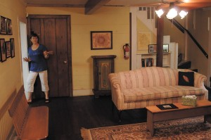 Lynda Martin shows the living room of the Goodwin House in 2010. She represents the seventh generation of her family to own the Brookhaven home. (Photo Phil Mosier).