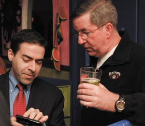 District 80 Rep. Mike Jacobs, left, chats with newly elected District 79 Rep. Tom Taylor.
