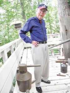 Joe Dabney with copper still at his Brookhaven home.