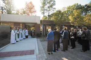 A crowd listens to the blessing of the Ignatius House's new 4,000- square-foot resource center on Oct. 25.