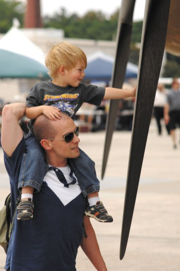 Nick Aliffi, a former member of the US Marine Corps, gives son Jack, 2, a bird's-eye view of a plane.