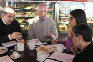 From left, Councilman Joe Gebbia, Councilman Jim Eyre, Maria Duarte and Irma Walker meet for breakfast to discuss ways to engage Brookhaven's Spanish-speaking residents.