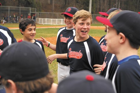 From left, Max Marion, Hudson Fletcher and Jake Oliver, members of the Dunwoody Middle School baseball league, congratulate each other after beating Greater Atlanta Christian School, 10-6 on March 9 in Dunwoody.