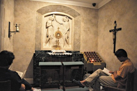 """Catholics practicing """"adoration,"""" an extended moment of quiet prayer, in Cathedral of Christ the King's Blessed Sacrament Chapel."""