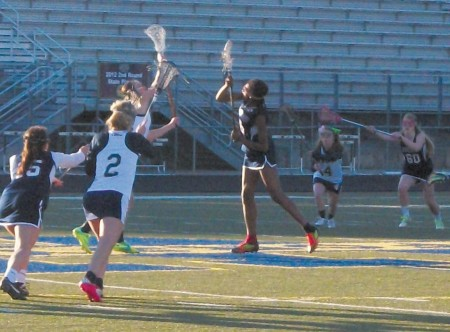 Photo By Ally Gaultney Seniors Anna Pruitt and Jamie Traner position themselves for a pass as their teammates attempt to get the ball. Senior Stephanie Powell defends the goal.