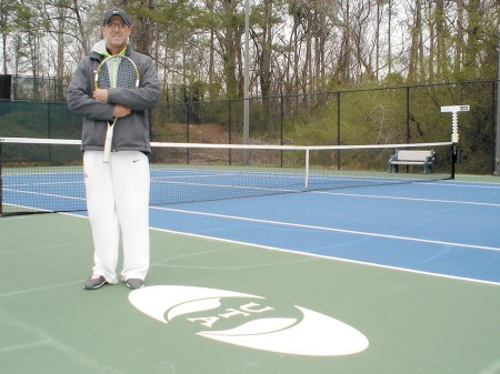 Stewart Russell, partner with Universal Tennis Academy/Management, stands proudly on one of Blackburn Tennis Center's newly resurfaced courts.