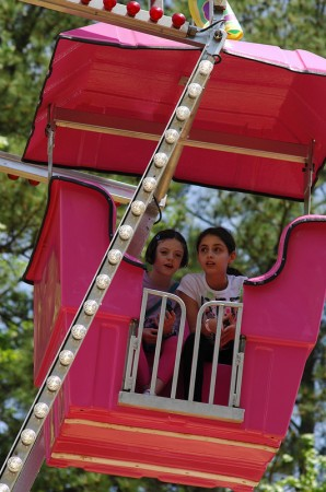 Enjoying a ride on the Ferris Wheel is best friends, left to right, Lauren Henderson, and Lily Bolson. They both attend the 3rd grade at Woodward Academy.