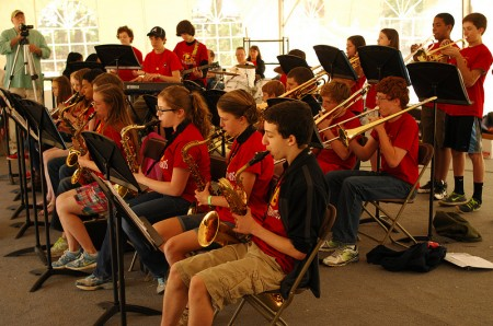 "New to festival this year were bands, and performers playing under a big tent. Peachtree Charter Middle School ""Blue Shadow Jazz Band"" performs. Yotam Kanny, an eighth grader plays the bass saxophone."
