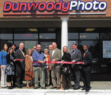 Dunwoody Photo, located at 5588 Chamblee-Dunwoody Road in Dunwoody, offers a variety of print services, including finishing, enlargements and film processing, and marked their opening with a ribbon-cutting ceremony hosted by the Dunwoody Chamber of Commerce. From left,  Kathleen Cabero, Christina Salzer, Juan Diego, Dunwoody City Councilman Terry Nall, Jean Beattie, Gary Beattie, Michael Beattie, owner, Debbie Fuse, Glen Fuse, Dunwoody Mayor Mike Davis, Sara Massey, Norman Collins and Ken Manous.
