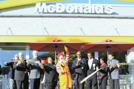 Sandy Springs' officials joined Ronald McDonald and restaurant owners Joyce Stafford, center left, and Allen Stafford, center right, on April 12 to commemorate the re-opening of the McDonald's location at 6360 Powers Ferry Road.  Others attending the pre-grand opening reception were, left to right, J.M. Owens, president of the Greater Atlanta McDonald's Owners Association, Ron Comacho, Sandy Springs Councilman Chip Collins, Allen Stafford Jr., Vicki Chancellor and Luis Melendez.