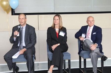 Left to right: Georgia Bankers Association vice president, Christine Parks, vice president of Morgan Stanley Private Bank, and John Heagy, senior managing director of Hines, a development company, address the Perimeter Business Association on May 10.