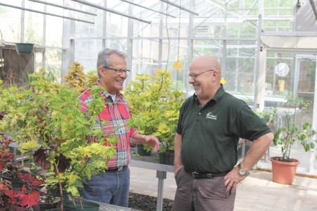 Allen Ferell, left, president of the Buckhead Men's Garden Club, discusses plants with member Cal Crutchfield.