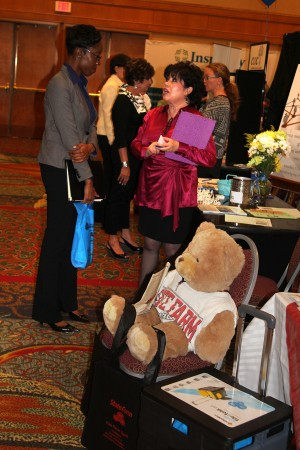 Claressa Hicklen, left, a financial advisor with Nestwise, chats with Rebecca Deutsch of the Buckhead Women's Business Group during the Greater Perimeter Business Expo in Dunwoody on May 2.