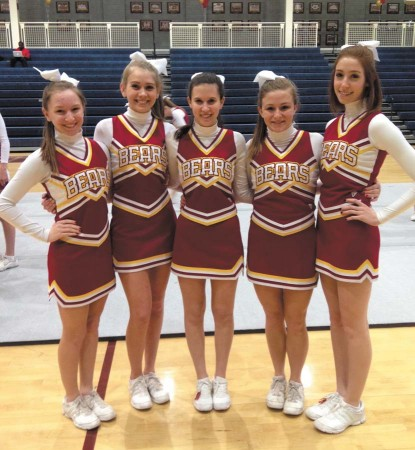 From left, Jordan McBride, Lindsey Klopfenstein, Cory Philipson, Alexandra Juneau and Stacy Bubes, five Varsity Basketball Cheerleaders at Holy Innocents'.