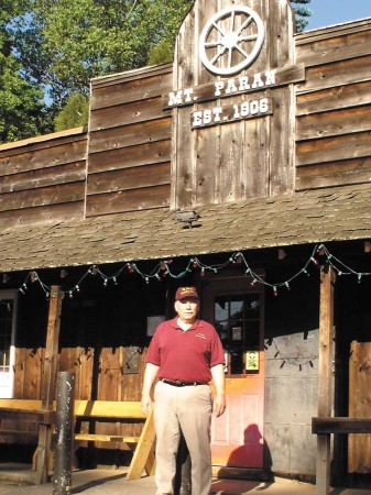 Pete Chevallier stands in front of the Mount Paran Country Store, located at the intersection of Northside Drive and Mount Paran Road in Buckhead. Chevallier, who owns the store with his wife, Jan, says they love interacting with their customers, who come in for gas, food and supplies.