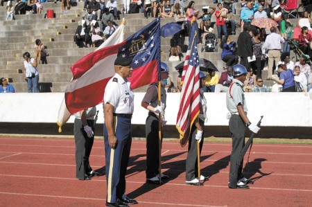First Sergeant Horton, U.S. Army, front, with the JROTC Color Guard.