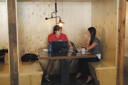 Blake Sanchez, president and CEO of Pyrodynamics, left, works alongside Erynne Ligeski, marketing director for the company, at the Roam office.