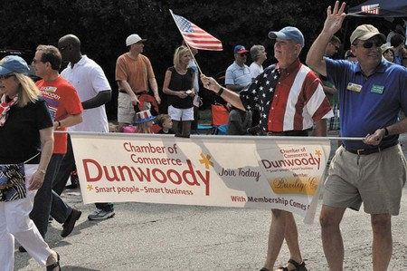 Members of the Dunwoody Chamber of Commerce march in the city's 2012 Fourth of July parade.