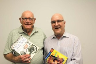 Ray Redmond, left, and Jim Saunders collected used children's books for Woodward Elementary students by combing Goodwill and other thrift shops, and by checking with book-trading websites.