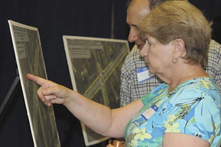 Rosanne and Harry Lutz examine illustrations showing the turn lanes proposed for Mount Vernon and Vermack roads. They  viewed the renderings during a public meeting on June 17.