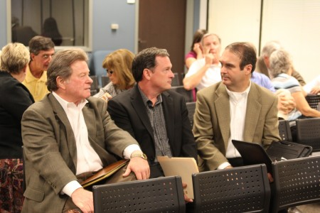 Henly Shelton, Sam Eads and Jim Riticher, left to right, attend the Dunwoody City Council meeting July 22. The three announced  they plan to run for seats on the council.