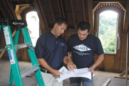 Randy Glazer, left, goes over design plans with Francois Lodde,  director of operations for Glazer Design and Construction.